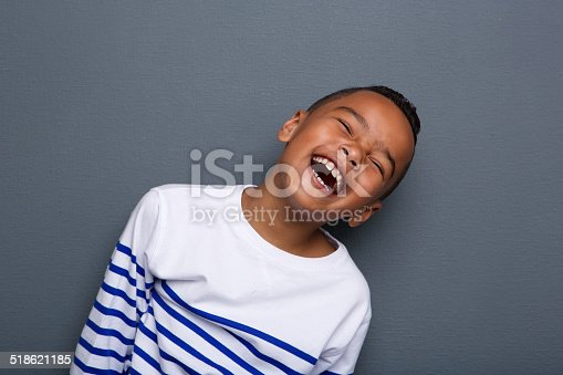 istock Close up portrait of a happy little boy smiling 518621185