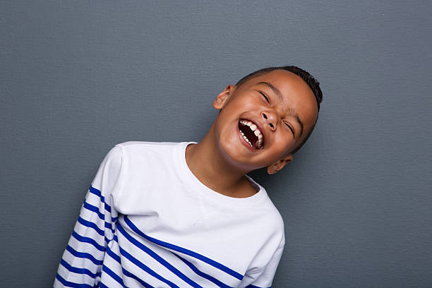 Close up portrait of a happy little boy smiling stock photo