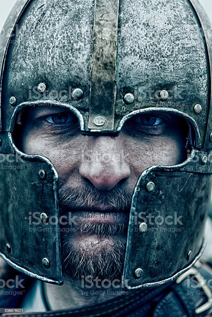 Close up portrait of a knight wearing a helmet stock photo
