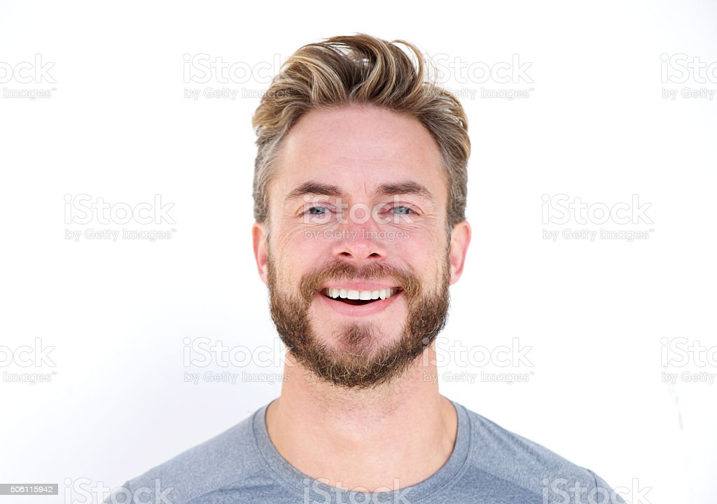 Close up portrait of a man with beard laughing stock photo