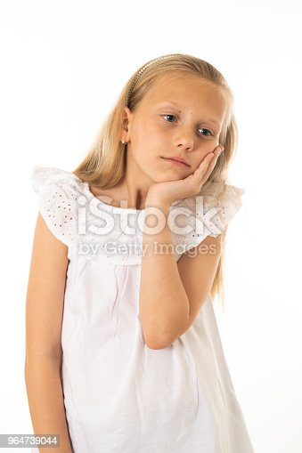 Close Up Portrait Of A Pretty Bored Depressed Alone Tired Restless Child Resting Her Face On Hand Isolated Withe Background Human Emotions Facial Expressions Body Language And Feelings Stock Photo & More Pictures of Beauty