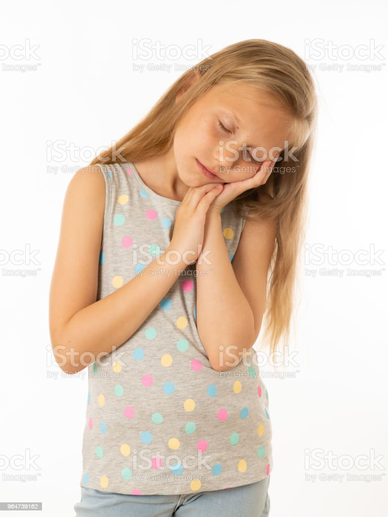 Close up portrait of a pretty bored, depressed, alone, tired, restless child resting her face on hand. Isolated withe background. Human emotions, facial expressions, body language and feelings royalty-free stock photo