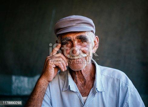 Close up portrait of a senior man over dark background, Erzincan, Turkey