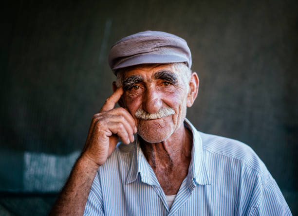 Close up portrait of a senior man over dark background Close up portrait of a senior man over dark background, Erzincan, Turkey anatolia stock pictures, royalty-free photos & images