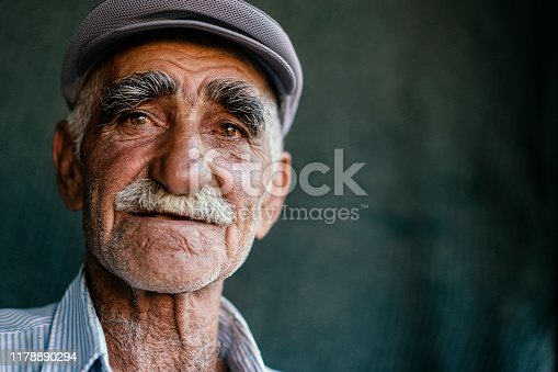 Close up portrait of a senior man over dark background, Erzincan, Turkey