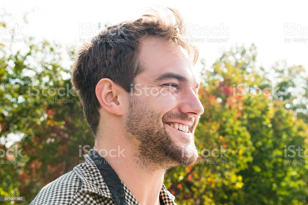Close Up Portrait of a Smiling Caucasian American Man Outdoors stock photo