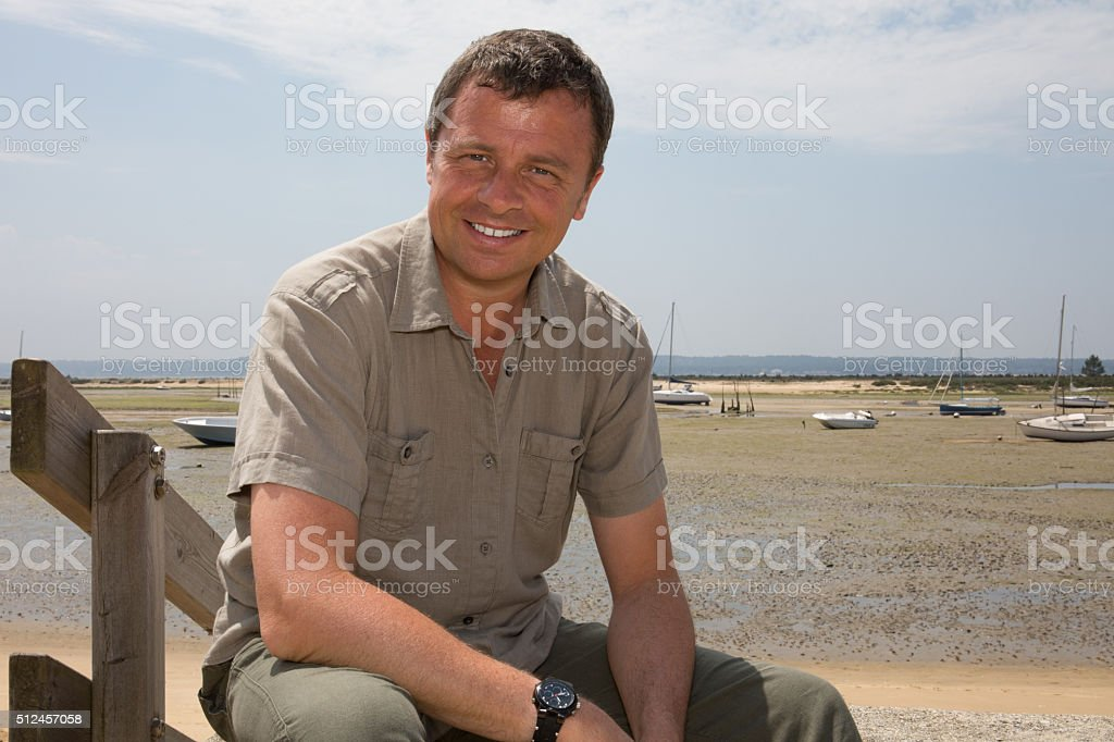 Close up portrait of a smiling handsome man stock photo