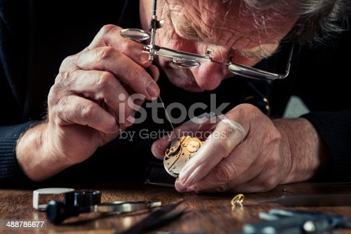 Close up of a watchmaker at work.