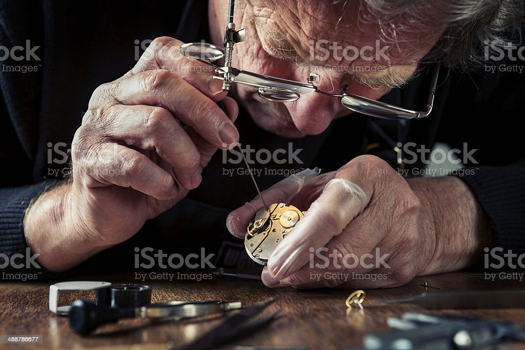 Close Up Portrait of a Watchmaker at Work stock photo