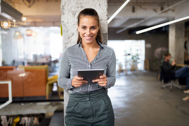 Close up portrait of a young business woman using digital tablet. stock photo