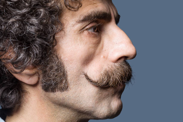 Close Up Portrait Of Adult Man With Handlebar Mustache stock photo