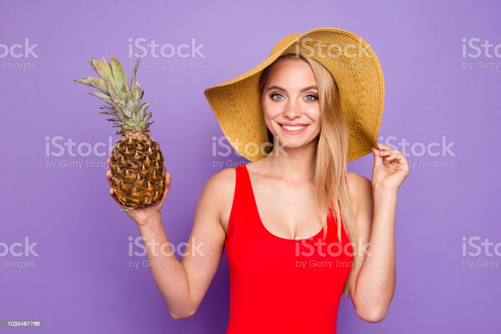 Close Up Portrait Of Beautiful And Kind Girl Holds A Pineapple In Her Hand And Looks