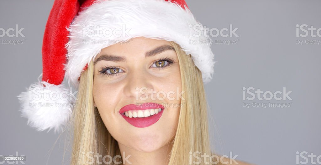 Close up portrait of beautiful blond girl in Santa Claus foto royalty-free
