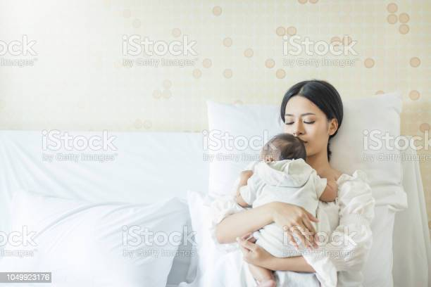Close up portrait of beautiful young asian mother with newborn baby picture id1049923176?b=1&k=6&m=1049923176&s=612x612&h=rcjylhsvc elie7ddsdhhft5n58efljlapqhrh6sxe4=