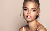 istock Close up portrait of beautifully looking young blonde haired woman, dressed in a delicate evening makeup. Elegance and hairstyling. 1198296948