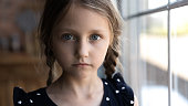istock Close up portrait of Caucasian sad little girl 1270508853