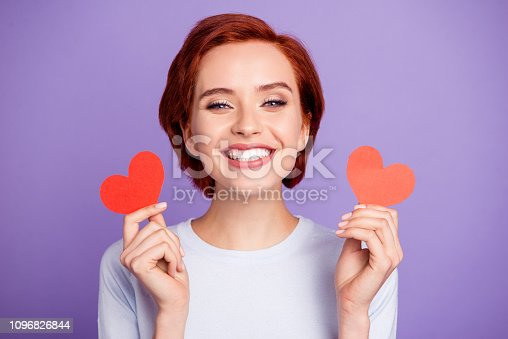 Close up portrait of cheer crazy beautiful she her girl holding paper cards in hands toothy gladly wide smiling inviting boyfriend on date isolated on violet background