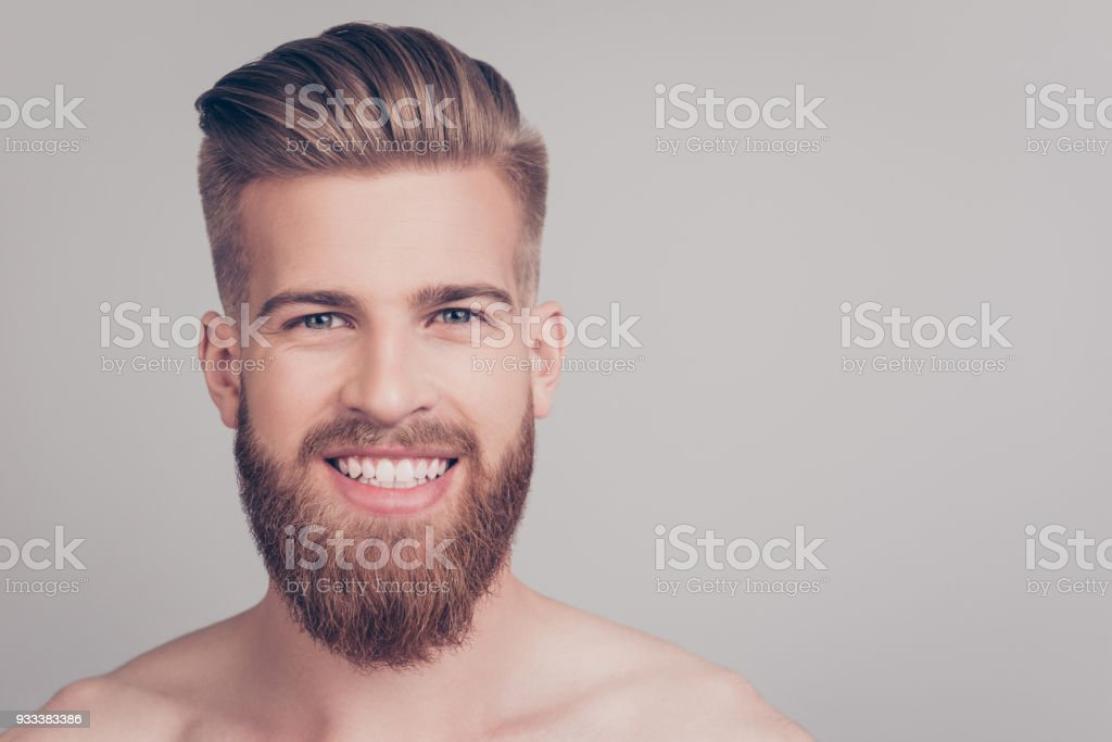 Close up portrait of cheerful handsome attractive excited satisfied emotional brutal kind friendly attractive stunning macho with stylish modern haircut isolated on gray background copy-space stock photo
