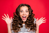 istock Close up portrait of cheerful yelling with voice she her girl glad black friday finally started wave amazing hair on shoulders white striped pullover isolated on red bright vivid background 1097375854