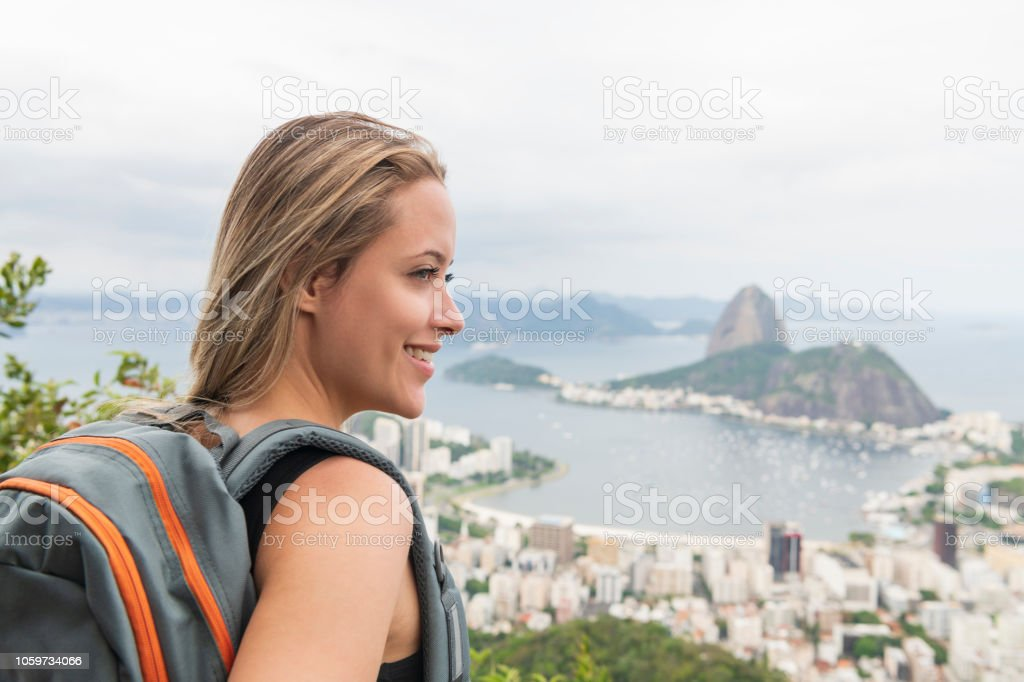 Close up portrait of cheerful young woman overlooking Sugar Loaf Mountain stock photo