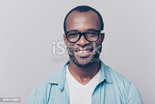 istock Close up portrait of confident handsome clever cheerful joyful university professor wearing casual denim jeans shirt and black rim-glasses, isolated on gray background 925470892