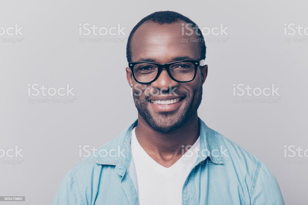 Close up portrait of confident handsome clever cheerful joyful university professor wearing casual denim jeans shirt and black rim-glasses, isolated on gray background - fotografia de stock