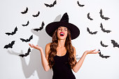 Close up portrait of cruel paranormal curly lady with angry expression close eyes and laugh raised hand up isolated on white background