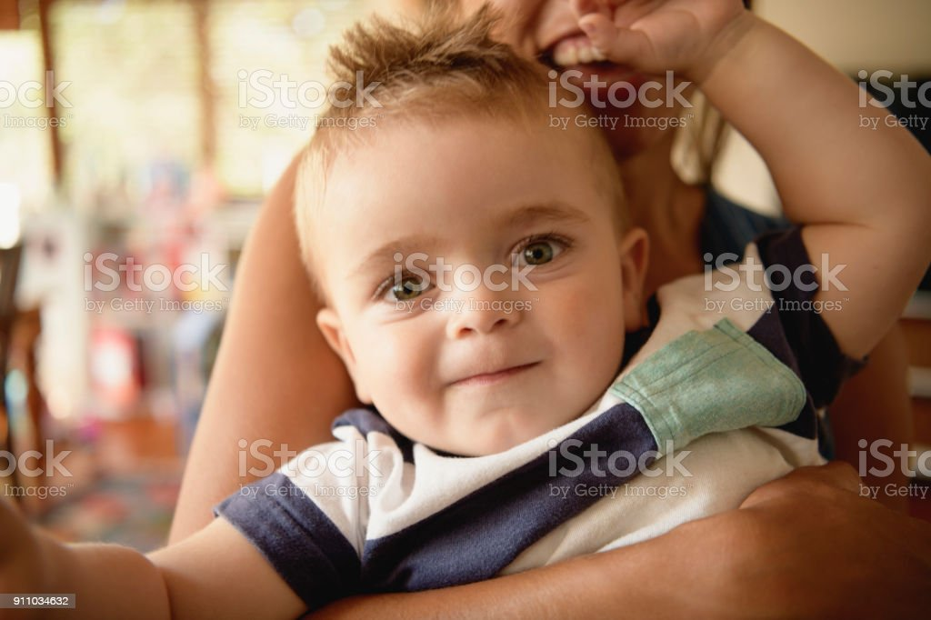 Close up portrait of cute young boy looking towards camera stock photo
