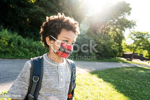 Close up portrait of Elementary school student wearing mask outdoor  to help prevent the spread of COVID-19