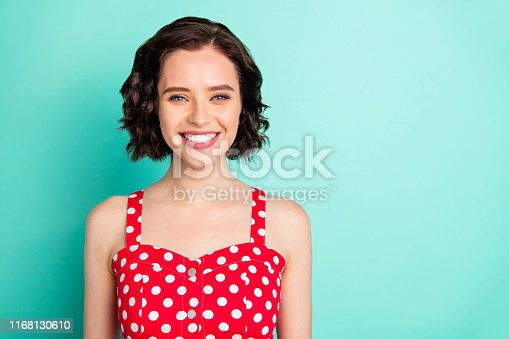 Close up portrait of fascinating young, beautiful wonderful lady posing in front of came while isolated with teal background