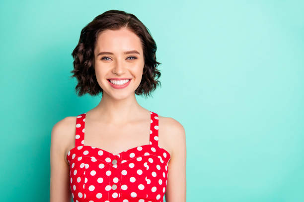close up portrait of fascinating young beautiful wonderful lady posing in front of came while isolated with teal background - capelli corti foto e immagini stock