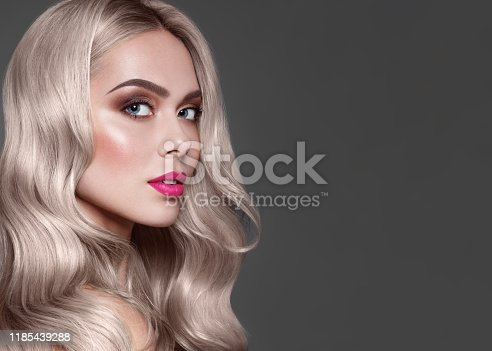 Close up portrait of fashion brown haired model with stylish make up, pink lips and brown eye shadow. Dye for Hair coloring.