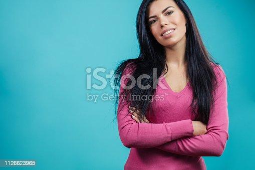 istock close up portrait of gorgeous confident brunette 1126623965