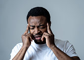 istock Close up portrait of handsome young african american man with headache suffering from migraines, hands on temples eyes closed showing strong pain. Facial expressions, people and Health care concept. 1162116279