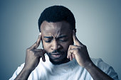 istock Close up portrait of handsome young african american man with headache suffering from migraines, hands on temples eyes closed showing strong pain. Facial expressions, people and Health care concept. 1162117385