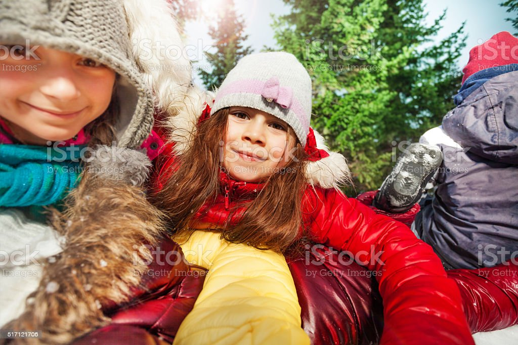 Close up portrait of happy girls at winter forest stock photo