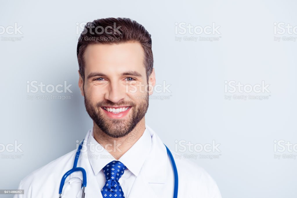 Close up portrait of happy smiling doctor in uniform isolated on white background stock photo
