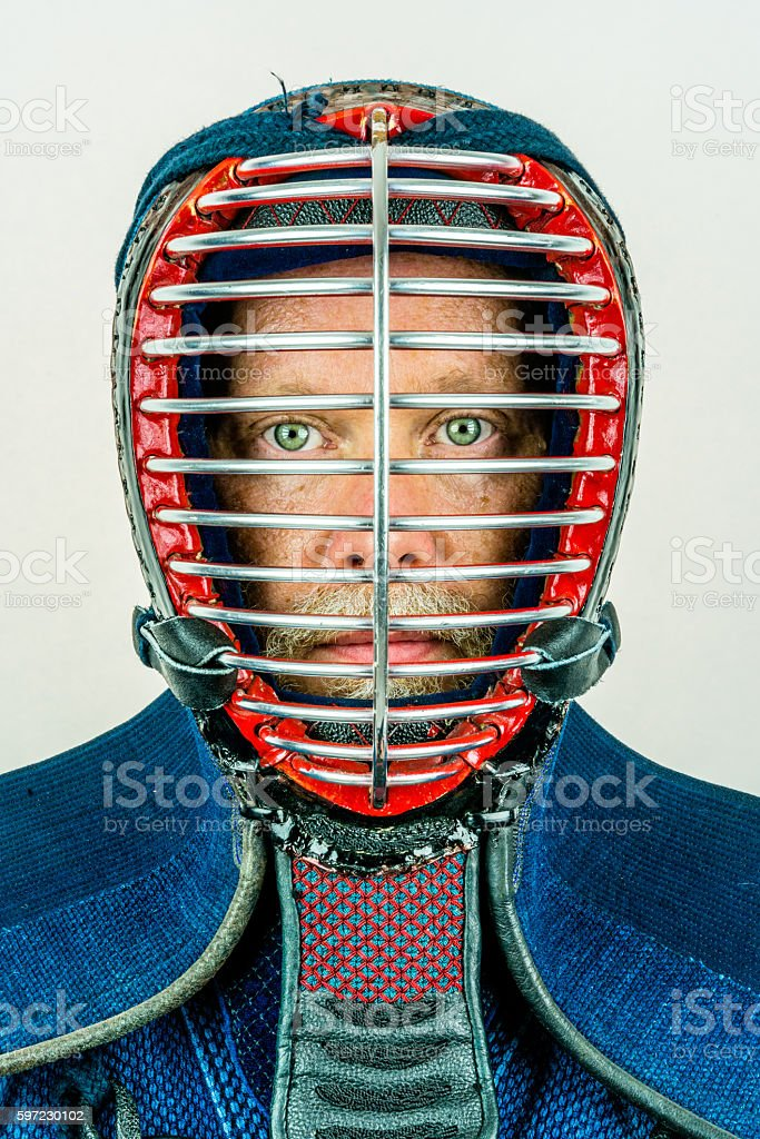 Close up portrait of man in kendo helmet. royalty-free stock photo