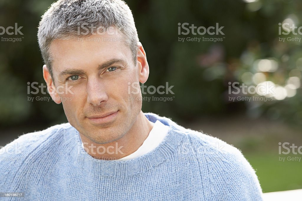 Close Up Portrait Of Man Standing Outside In Autumn Landscape stock photo