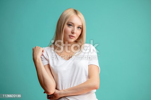 1126620182istockphoto close up portrait of nice hipster in casual clothes looking at the camera 1126620135