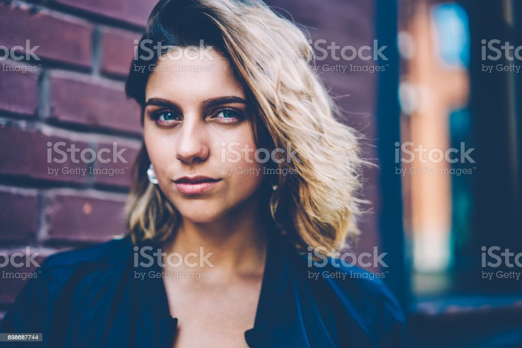 Close Up Portrait Of Serious Young Hipster Girl With Short Haircut
