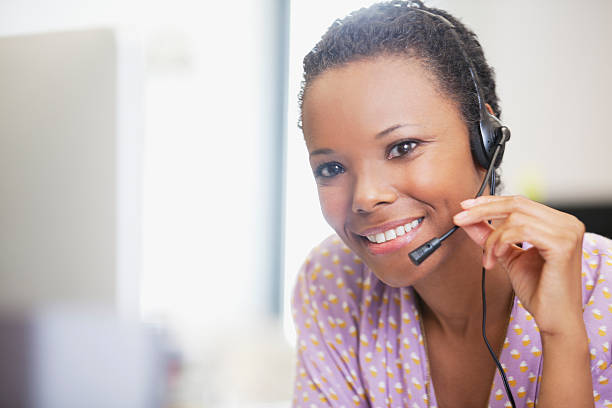 Close up portrait of smiling businesswoman with headset  hands free device stock pictures, royalty-free photos & images