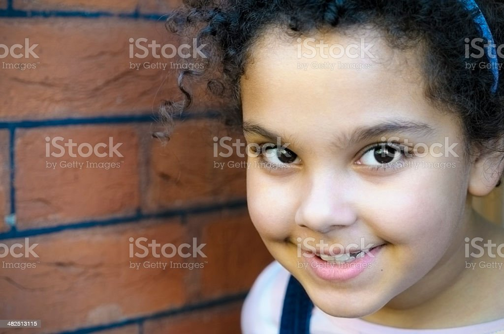 PEOPLE: Close Up Portrait Of Smiling Child (7-8) royalty-free stock photo