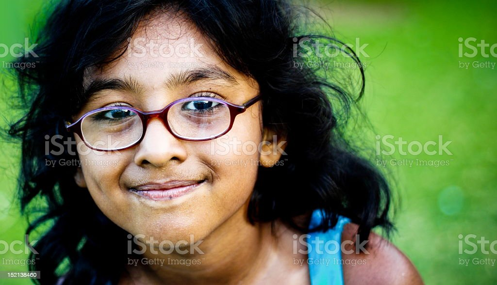 Close up portrait of smiling girl with glasses royalty-free stock photo