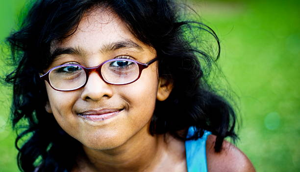 Close up portrait of smiling girl with glasses stock photo