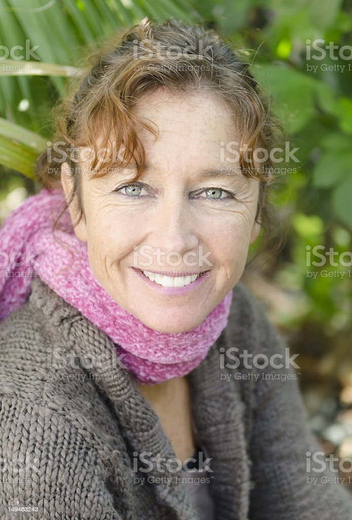 Close up portrait of smiling mature woman stock photo