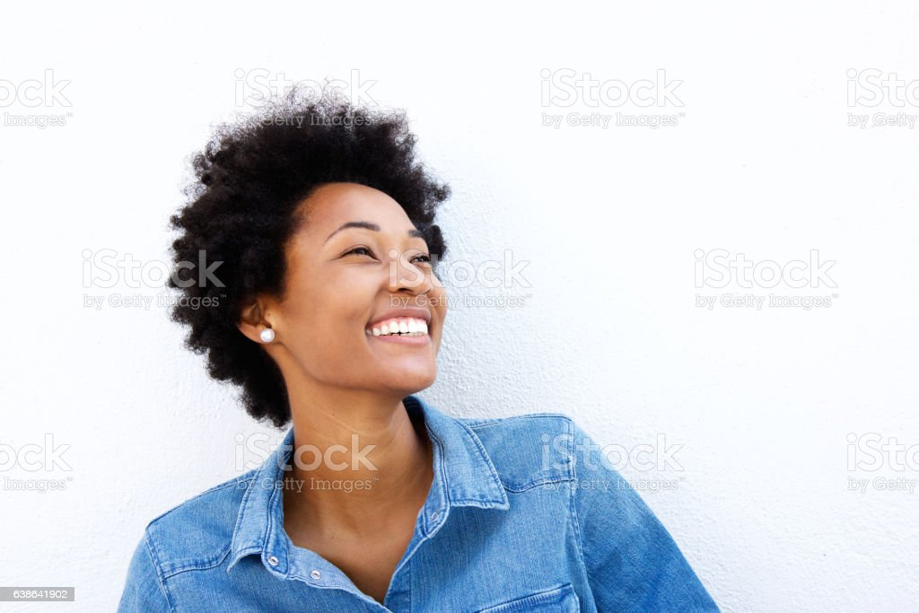 Close up portrait of smiling woman looking up stock photo