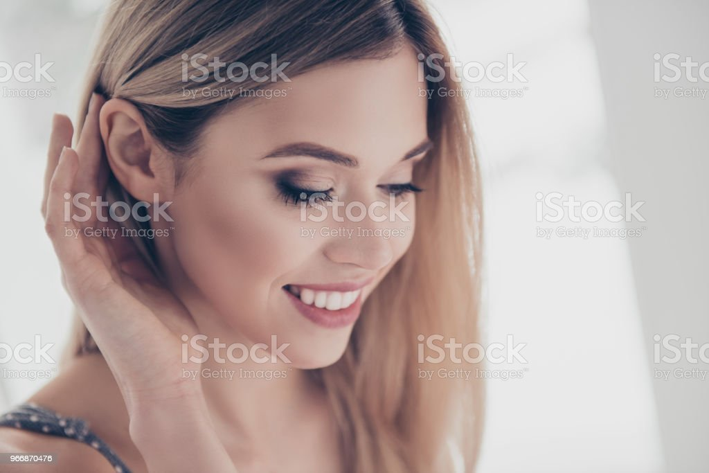 Close up portrait of successful, pretty, charming, gorgeous, cheerful, cute, modern, naked, nude, natural, positive, correcting her hair behind ear, skincare, bodycare, healthcare concept stock photo