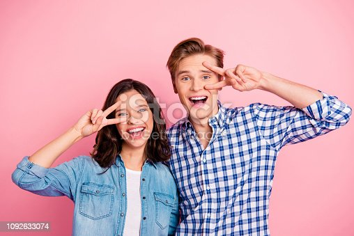 Close up portrait of two she her he him his boy lady showing v-sign near eyes going to dance party wearing casual shirts denim plaid outfit isolated on rose background