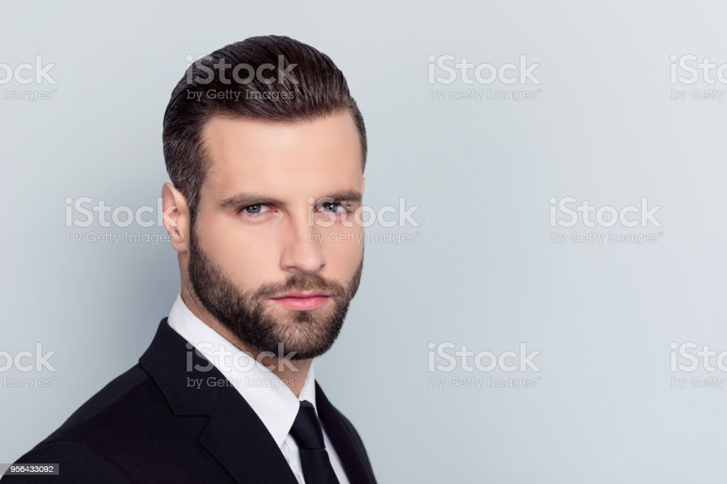 Close up portrait of virile masculine handsome attractive clever intelligent experienced qualified with modern hairdo strict confident expert white shirt tie isolated on gray background stock photo